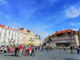 Background of Jan Hus Sculture and Kinsky Palace